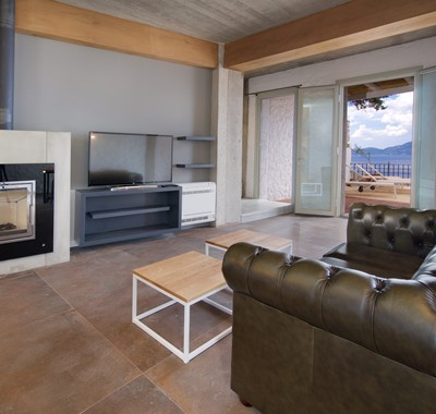 Lounge space with TV and fire inside Villa Vivere, Assos, Kefalonia