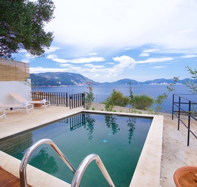 Pool, sun loungers and views outside Villa Vivere, Assos, Kefalonia