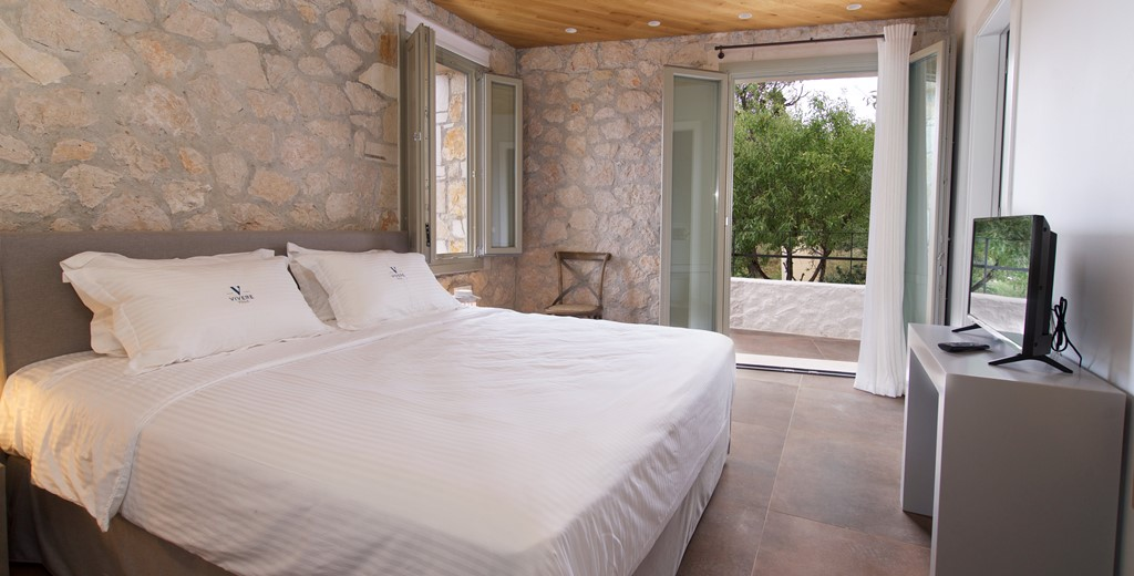 Bedroom and French doors leading outside Villa Vivere, Assos, Kefalonia