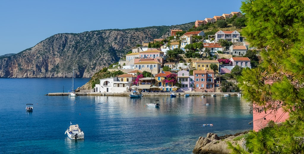Traditional Greek villas nestled between the hills and waterfront in teh village of Assos, Kefalonia