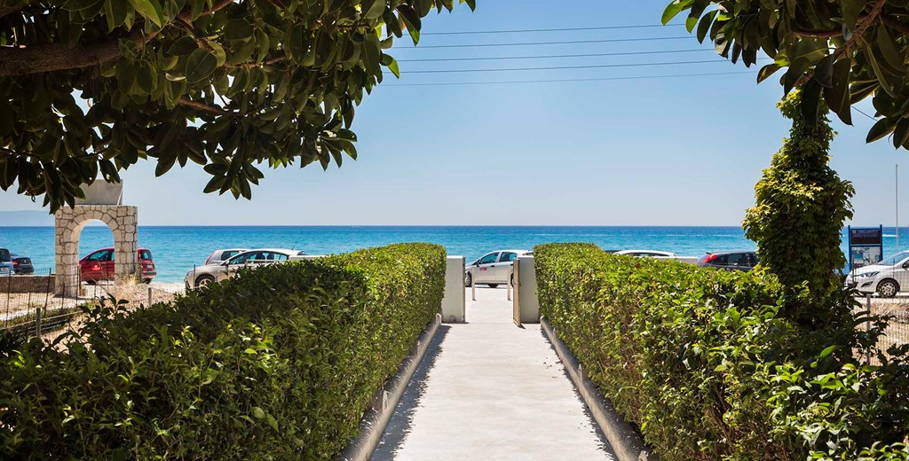 Lined path to the sea outside Beachfront Suites, Lourdata, Kefalonia