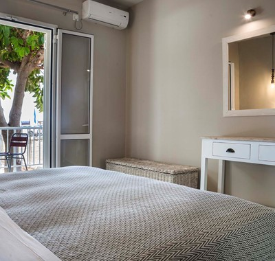 Bedroom with outside seating and air conditioning Beachfront Suite No1, Lourdata, Kefalonia