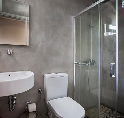 Bathroom with shower and basin inside Beachfront Suite No1, Lourdata, Kefalonia