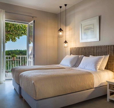Bedroom and French doors opening onto sea views inside Beachfront Suite No2, Lourdata, Kefalonia
