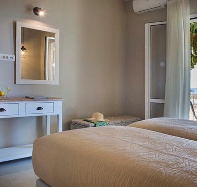 Plenty of room to get ready for the day inside the bedroom at Beachfront Suite No2, Lourdata, Kefalonia