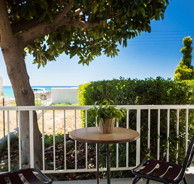 Escape the sun and drink or dine al fresco in the shade outside Beachfront Suite No2, Lourdata, Kefalonia