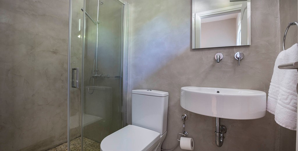 Bathroom with shower and basin inside Beachfront Suite No2, Lourdata, Kefalonia