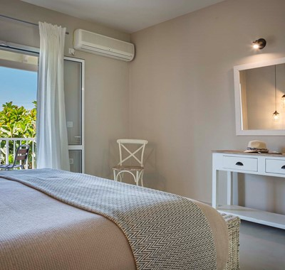 Bedroom with double bed and plenty of space to prepare for the day or evening inside Beachfront Suite No3, Lourdata, Kefalonia