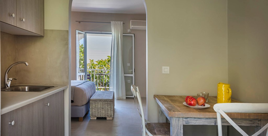 Dining, kitchen space looking through the bedroom to the sea views from Beachfront Suite No3, Lourdata, Kefalonia
