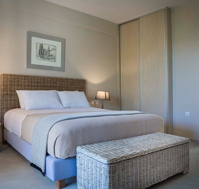 Bedroom with large double bed and plenty of space to store your belongings during your holiday at Beachfront Suite No4, Lourdata, Kefalonia