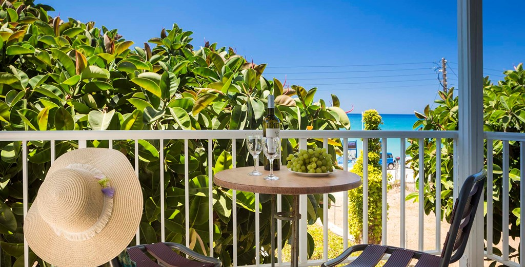 Private treetop balcony for lunch or dinner with a view of the mediteranean sea at Beachfront Suite No4, Lourdata, Kefalonia