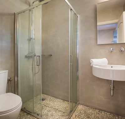 Bathroom with shower and basin inside Beachfront Suite No4, Lourdata, Kefalonia
