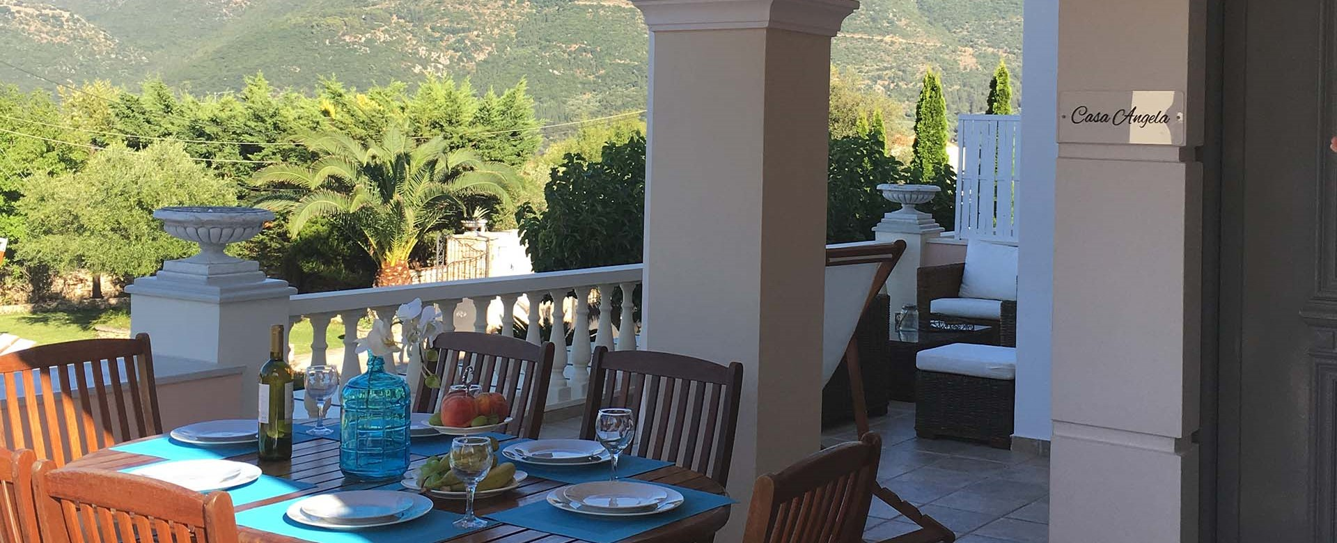 Al fresco dining with mountain views on the veranda at Casa Angela, Melissani Apartments, Karavomilos, Kefalonia, Greek Islands