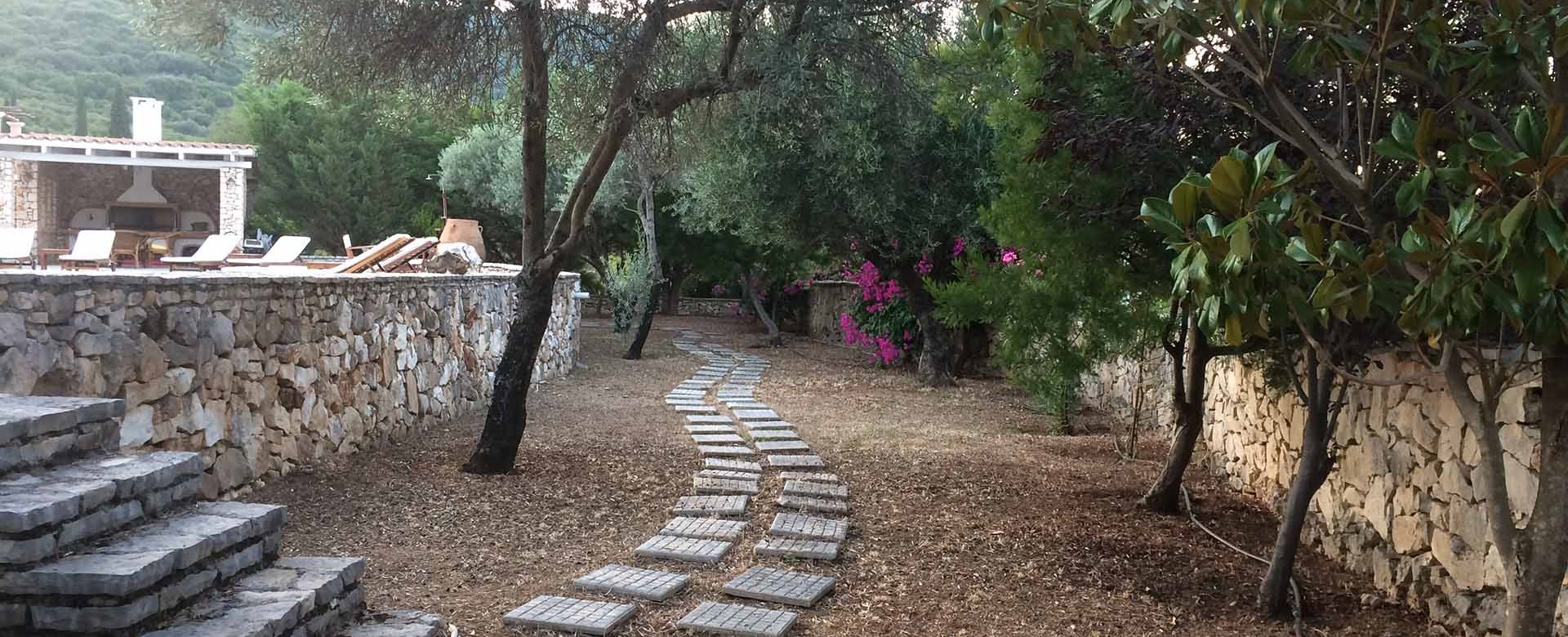 Stroll through the gardens of Melissani Apartments, Karavomilos, Kefalonia, Greek Islands