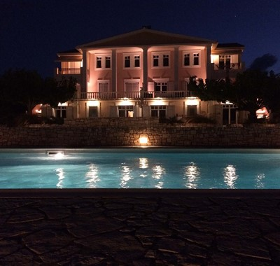 Evening lighting turns the Melissani Apartments into a stunning backdrop for you holiday in Kefalonia
