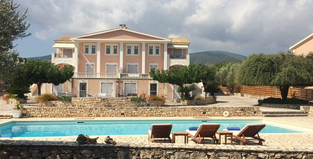 Outside view of Melissani Apartments including the pool and mountains of Kefalonia, Greek Islands