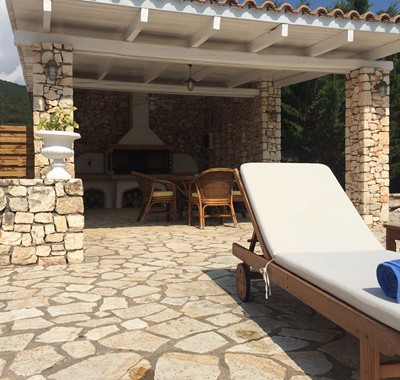 Pizza oven and covered outside seating at Melissani Apartments if the summer Kefalonia sun gets too hot