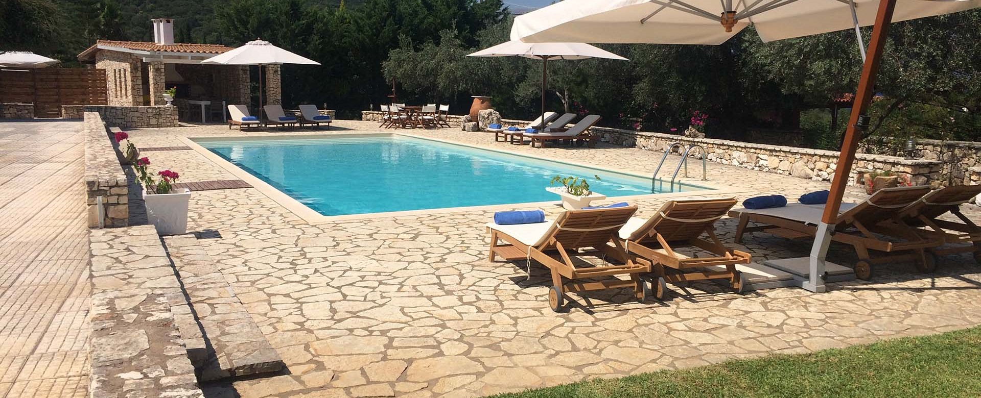 Pool sun loungers and mountain views at Casa Angela, Melissani Apartments, Karavomilos, Kefalonia, Greek Islands