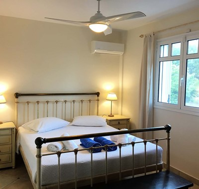 Double bedroom with air conditioning inside Casa Angela, Melissani Apartments, Karavomilos, Kefalonia, Greek Islands