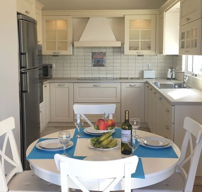 Kitchen and breakfast dining to start each morning of your holiday in Casa Angela, Melissani Apartments, Karavomilos, Kefalonia, Greek Islands