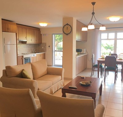 Open plan lounge kitchen and dining inside Casa Elena, Melissani Apartments, Karavomilos, Kefalonia, Greek Islands