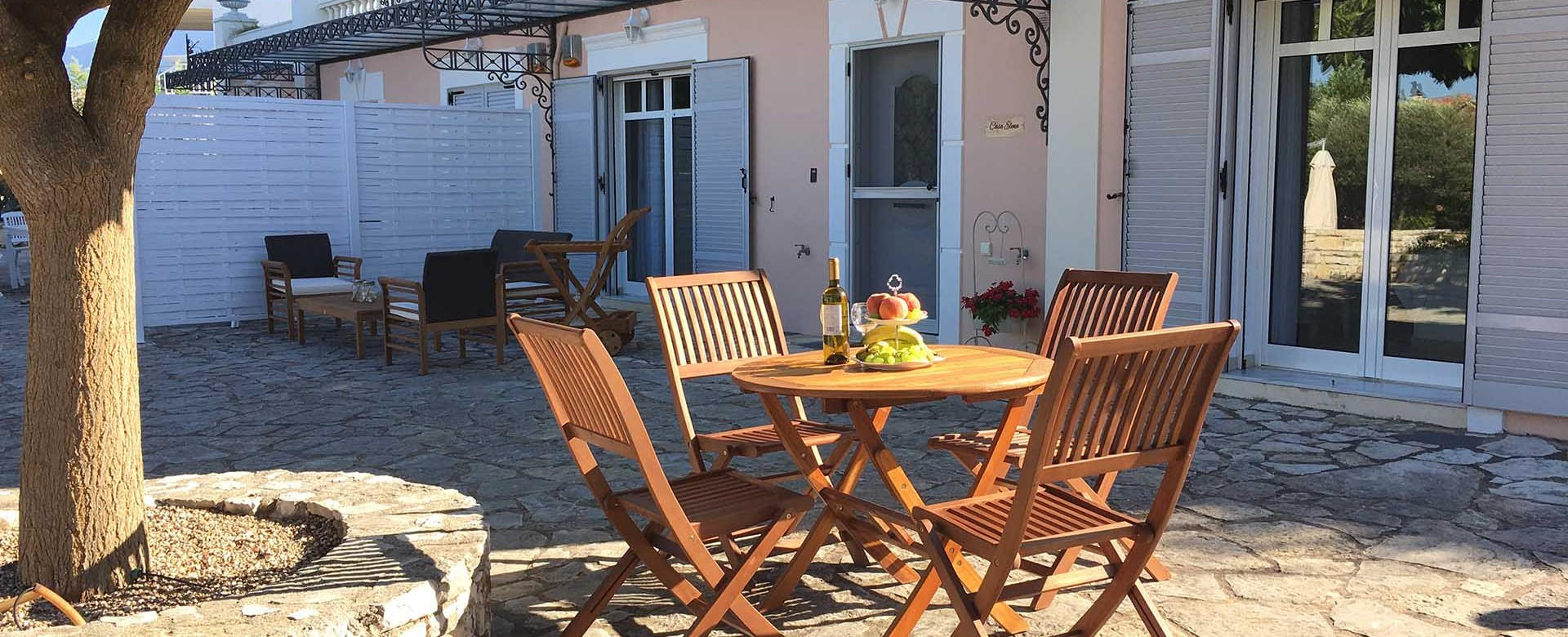 Relax in the evening sun with great company right outside Casa Elena, Melissani Apartments, Karavomilos, Kefalonia, Greek Islands