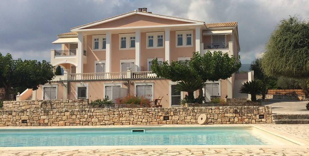 The pool and impressive Melissani Apartments in Karavomilos, Kefalonia, Greek Islands