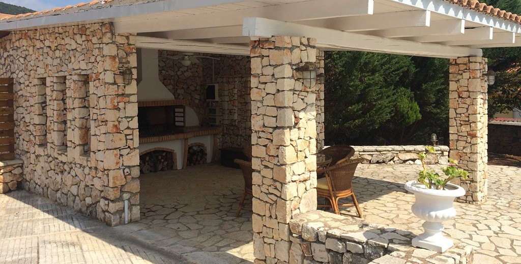 Pizza oven and shaded outside dining at Melissani Apartments, Karavomilos, Kefalonia, Greek Islands
