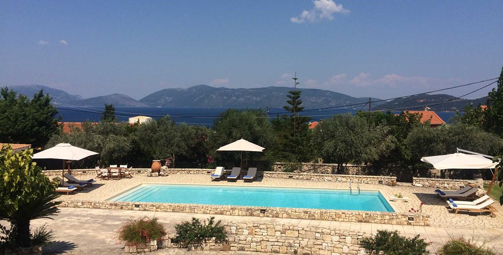 The pool, sea and mountain coastline make a great setting for a holiday in Melissani Apartments, Karavomilos, Kefalonia, Greek Islands