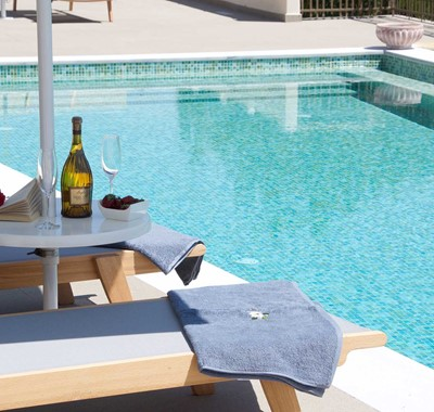 Reading and wine by the pool makes a relaxing holiday in Magnolia Apartments, Fiscardo, Kefalonia, Greek Islands