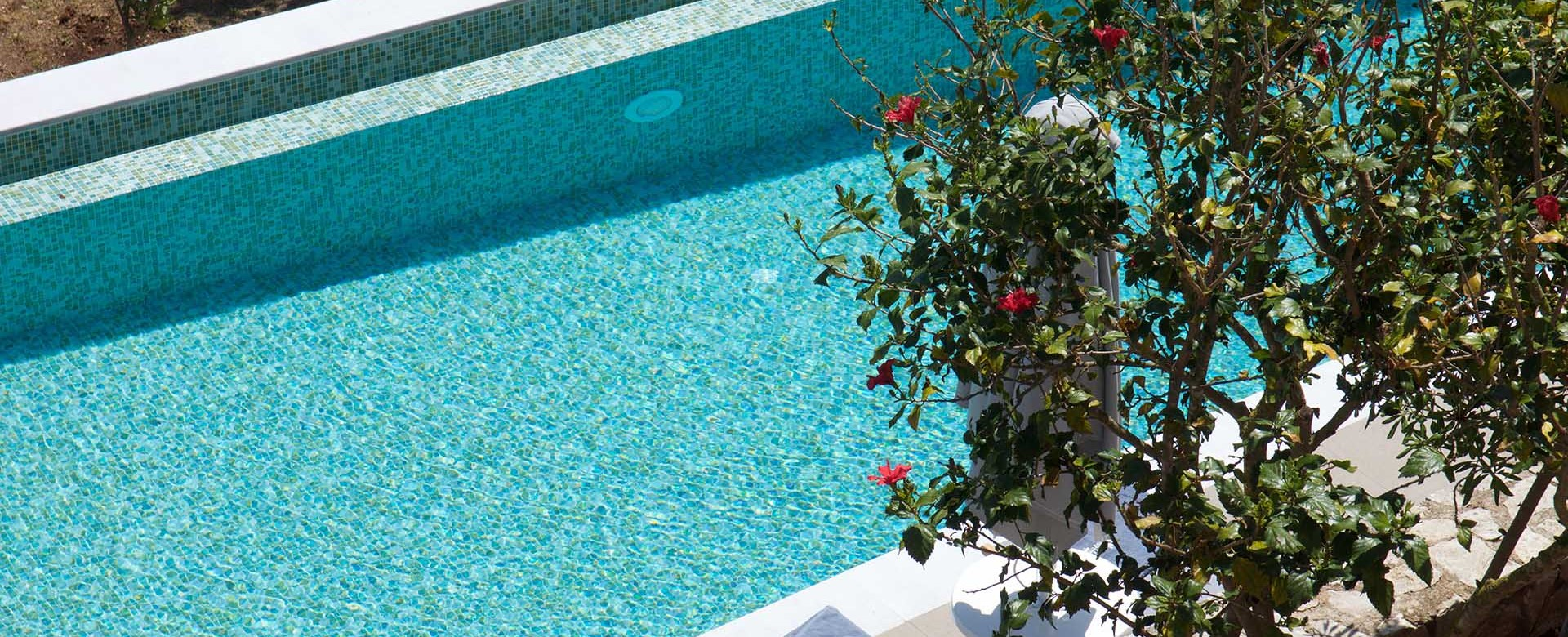 The pool invites you in straight from your room at Magnolia Apartments, Fiscardo, Kefalonia, Greek Islands