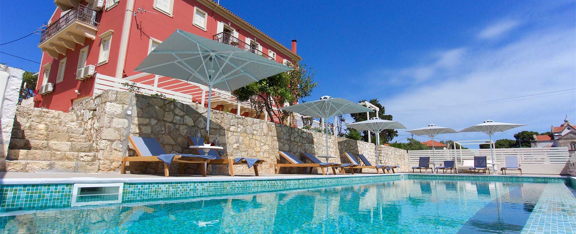 Relax in the pool and take in the sky during your holiday to Magnolia Apartments, Fiscardo, Kefalonia, Greek Islands