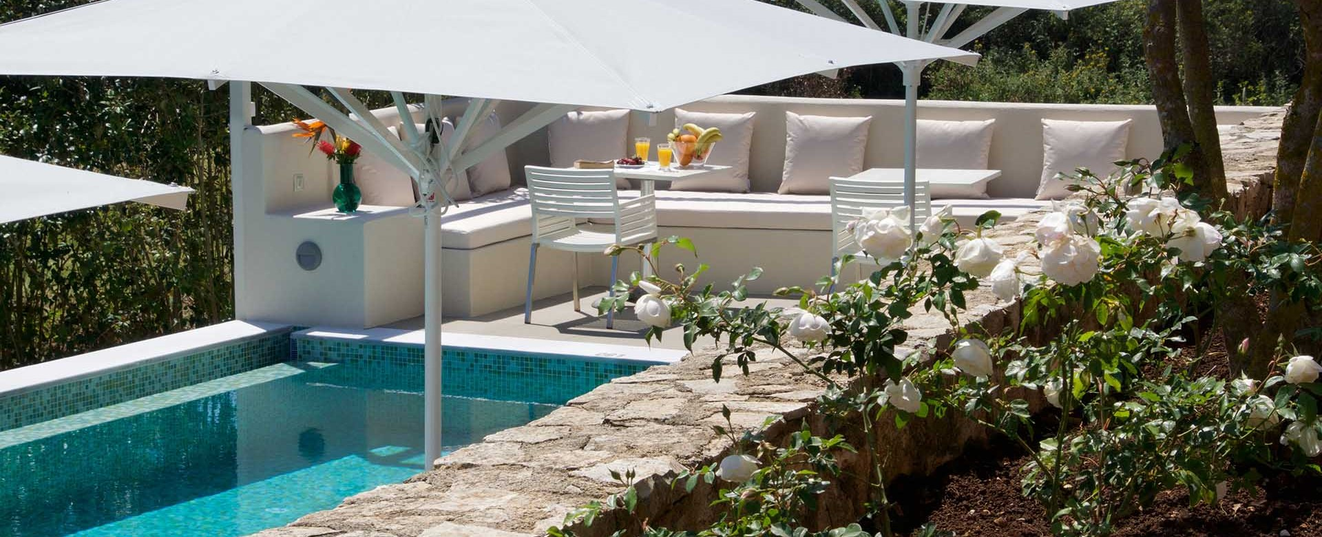 Gardens and outside seating at Magnolia Apartments, Fiscardo, Kefalonia, Greek Islands