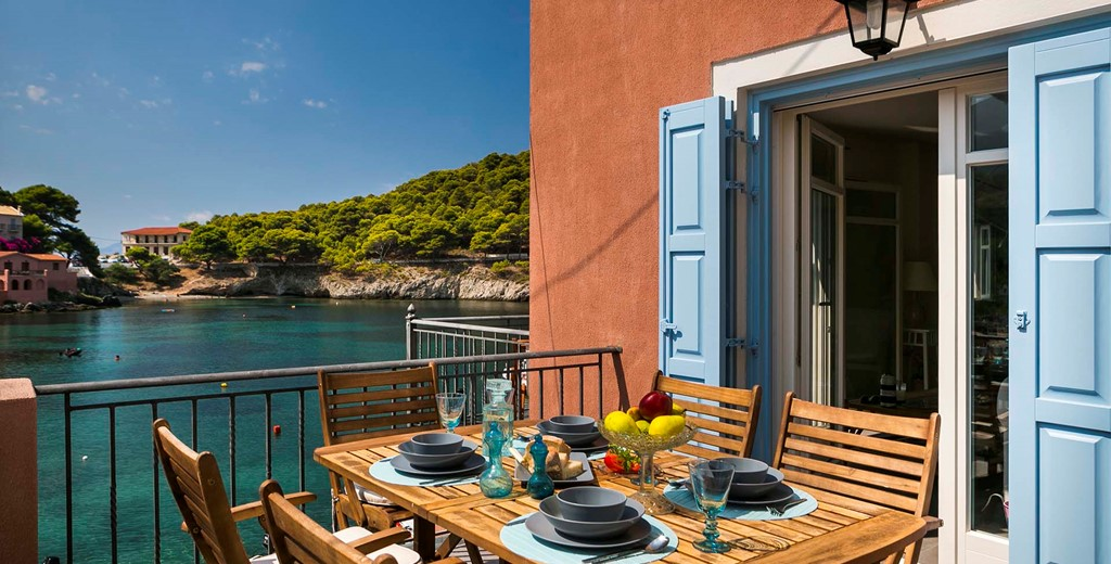 Al fresco dining on the waterfront balcony at Thalassa House, Assos, Kefalonia, Greek Islands