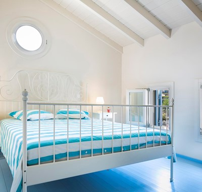 Clean bright open relaxed bedroom with double bed inside Thalassa House, Assos, Kefalonia, Greek Islands