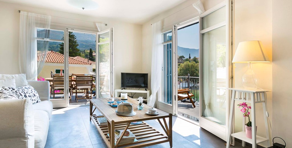 French doors lead to the balcony from the lounge space inside Thalassa House, Assos, Kefalonia, Greek Islands