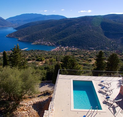 Aerial view showing the pool and Villa Amore looking down to the coast and hills in Agia Efimia, Kefalonia, Greek Islands