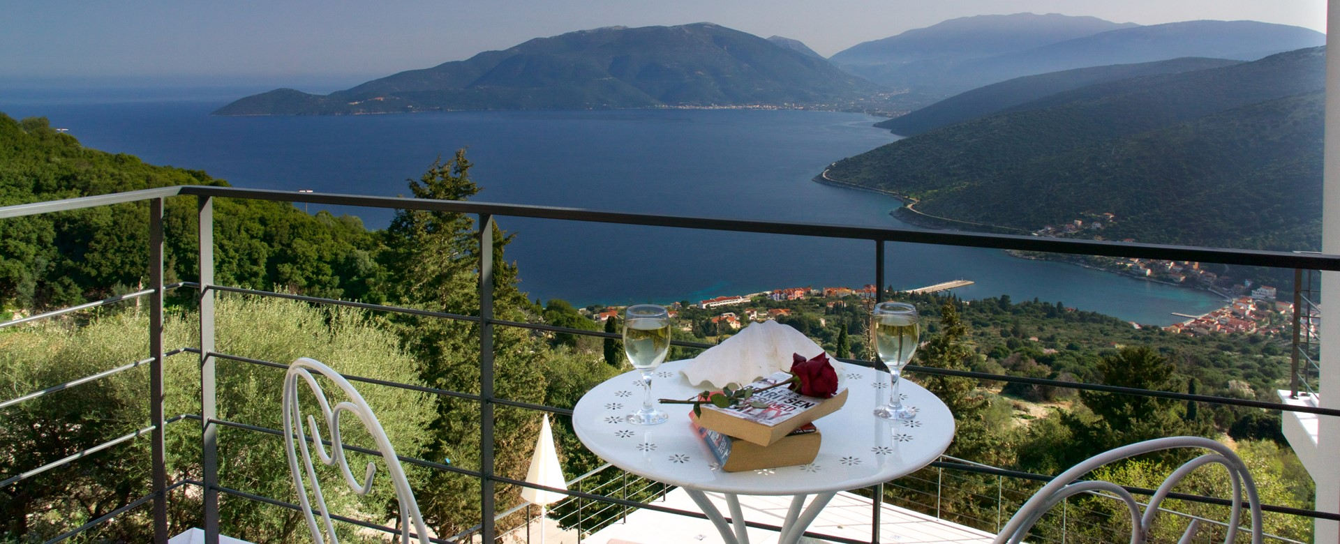 A quiet drink on the balcony at the end of a relaxing holiday staying in Villa Amore, Agia Efimia, Kefalonia, Greek Islands