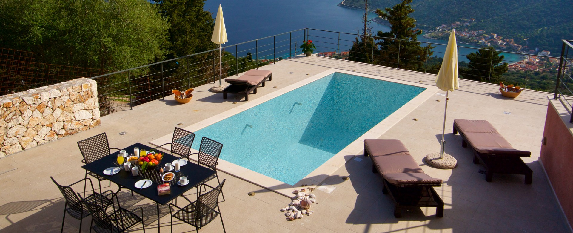 Outside dining, pool, sun beds and views outside Villa Amore, Agia Efimia, Kefalonia, Greek Islands