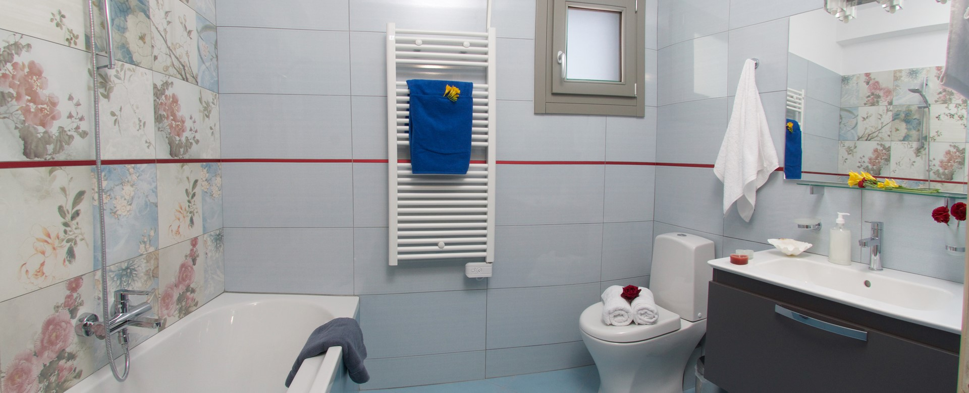 Bathroom with shower over bath and basin in  Villa Amore, Agia Efimia, Kefalonia, Greek Islands