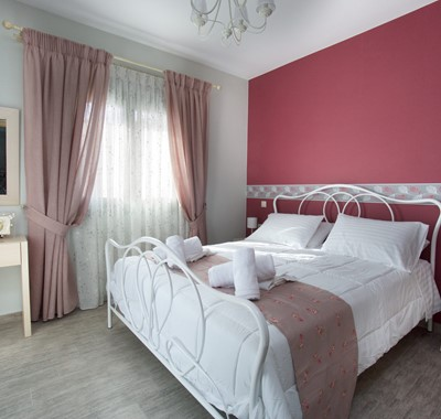 Master bedroom with large double bed inside Villa Amore, Agia Efimia, Kefalonia, Greek Islands