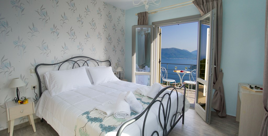 Bedroom with double bed, private balcony and stunning views from Villa Amore, Agia Efimia, Kefalonia, Greek Islands