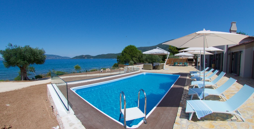 Pool sun beds and sea view outside Villa Frydi, Karavomilos, Kefalonia, Greek Islands