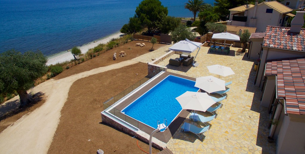 Aerial photo of the pool, patio space garden and beach at Villa Frydi, Karavomilos, Kefalonia, Greek Islands