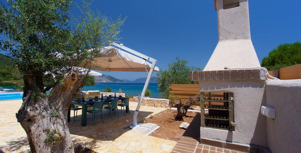 Oven and shaded al fresco dining space outside Villa Frydi, Karavomilos, Kefalonia, Greek Islands