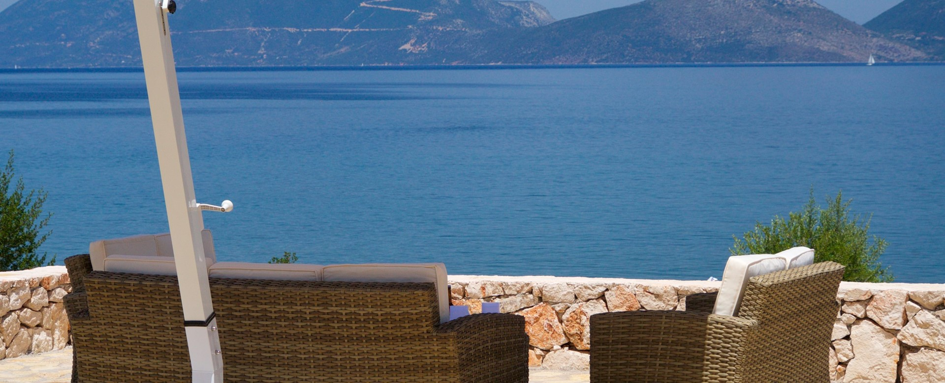 Take in the coastline views from the comfortable and shaded outside seating in Villa Frydi, Karavomilos, Kefalonia, Greek Islands