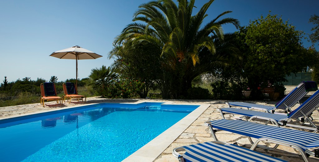View of pool and palms at Villa Nefeli, Fiscardo, Kefalonia
