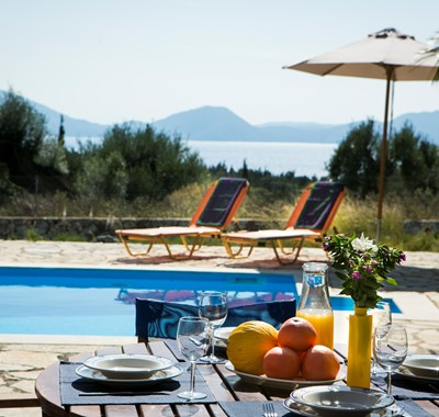 Fruit on the pool side table and views at Villa Nefeli, Fiscardo, Kefalonia