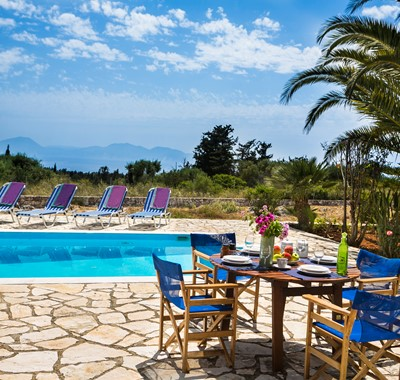 Poolside lunch and sun loungers at Villa Nefeli, Fiscardo, Kefalonia