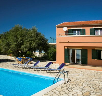 The pool balcony and sun loungers at Villa Nefeli, Fiscardo, Kefalonia